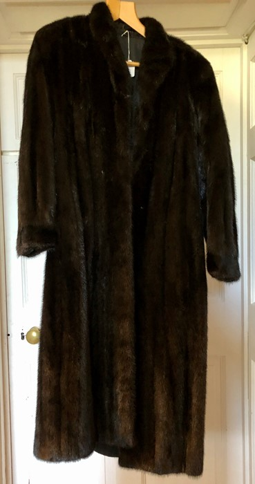 Lot 3324 - A blank ranch fur coat size 12 early 1980s. A small collar and sleeves that are gathered into the