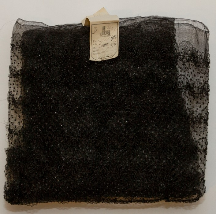 Lot 3326 - An original box containing black tulle, French milliners, Vielry, which is embellished with jet,