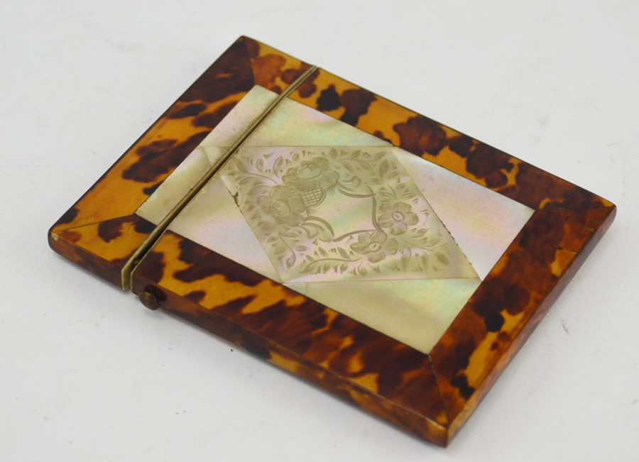 Lot 2535 - A 19th Century tortoiseshell calling card case, of rectangular form, central inset mother of pearl