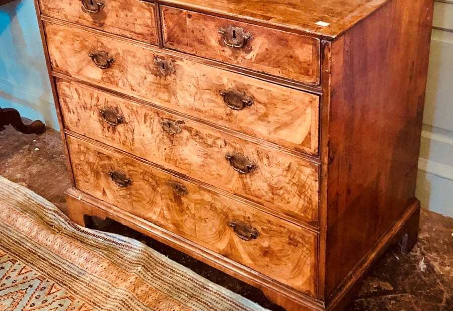 Lot 3038 - A George II figured walnut, double crossbanded and feather-banded chest of drawers, circa 1750,