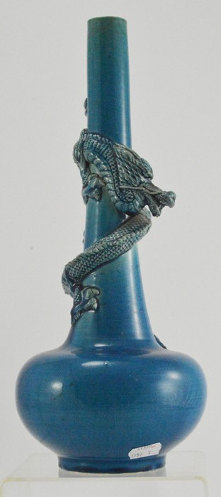 Lot 2493 - A 19th Century Chinese monochrome blue vase with a spiral dragon in high relief, a Famille Rose