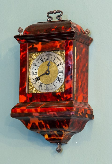 Lot 3001 - A miniature tortoiseshell bracket timepiece, of Georgian design, caddy top with white metal swing