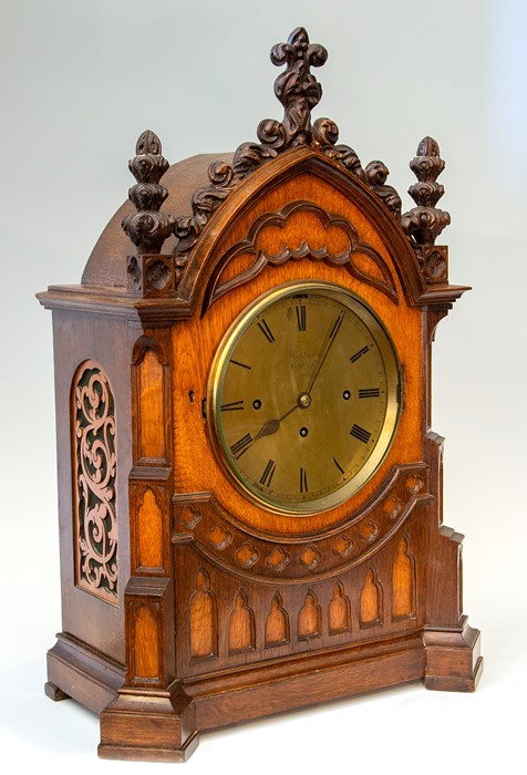 Lot 3003 - Kippax, Retford, a mid 19th Century musical oak bracket clock of Gothic Revival design, the arched