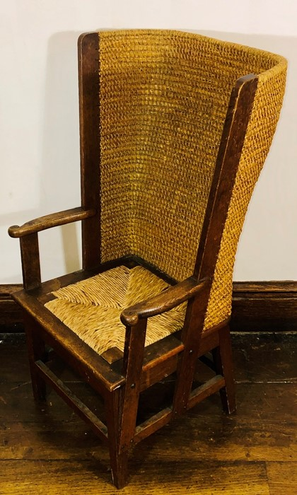 Lot 3039 - A 19th Century Orkney oak chair, oak joined with straw back flanked by open arm rest, raised on