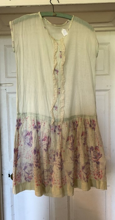 Lot 3303 - A circa 1920's/1930's silk fawn coloured pin tucked garment and a 1920's cotton lawn day dress,
