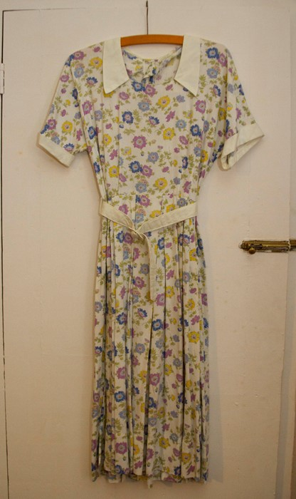 Lot 3305 - CC41 - A 1940's floral cotton day dress, with white collar, cuffs on short sleeves and a belt; a