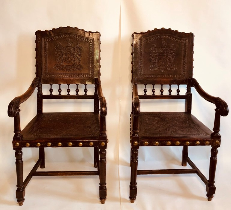 Lot 3044 - A pair mid 18th Century oak leather hall chairs, circa 1750, brass stud fitted leather back inlay of