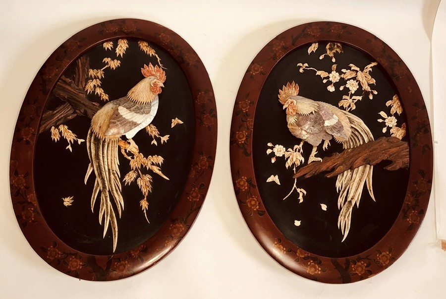 Lot 2500 - A pair of Meiji period Japanese shibayama wall plaques, circa 1870, red lacquered oval frame with