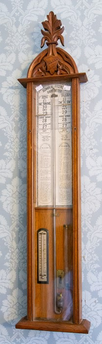 Lot 3009 - A late 19th century Admiral Fitzroy's barometer, oak case of Gothic design, height 118cm