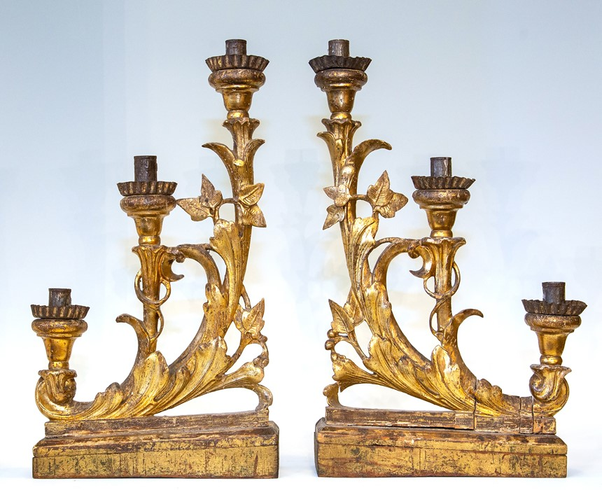 Lot 2515 - A pair of 18th Century Florentine gilt gesso triple branch candelabra, of scroll design, on wooden