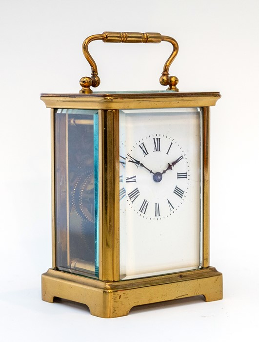 Lot 3008 - An early 20th Century carriage timepiece, brass corniche case, visible escapement, white enamel dial