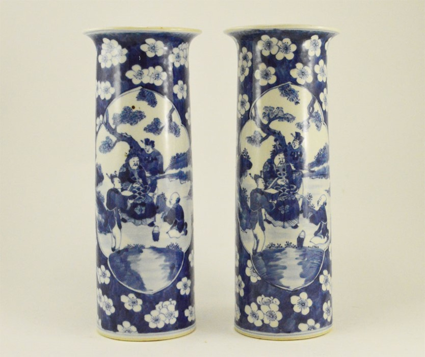 Lot 2478 - A pair of 19th Century Chinese hand-painted under-glaze tall blue and white vases with splayed rims,
