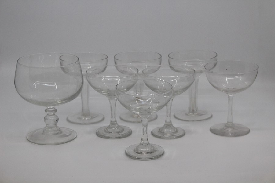 Lot 1409 - A group of Bohemian and other decorative glassware to include a pair of enamelled baluster vases,