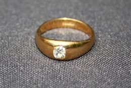 An 18ct yellow gold Gypsy set gents ring with mine cut diamond. 5gm gross weight