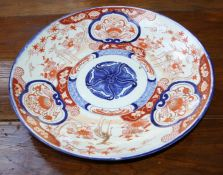 A Japanese Meiji Period Imari circular charger, decorated with reserves of browsing deer, 46cm diame