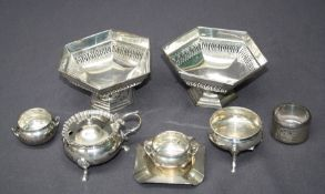 A pair of matching silver pressed bonbon dishes of octagonal form, together with a pair of cauldron
