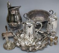 A collection of silver plated items including trophy cups, ice water jug, Sheffield plate desk stand
