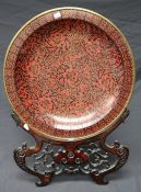 A large presentation Chinese cloisonne circular charger and hardwood stand. 52cm diameter Formally