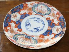 A Japanese late Meiji period Imari circular charger, typically decorated in the palette with floral