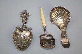 A George III silver caddy spoon with shell bowl and bright cut handle, London 1793, together with a