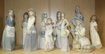 A Lladro figure of a young lady wearing a strapless gown holding a wide brimmed hat, together with t