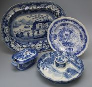 A small collection of blue and white transfer painted pottery wares to include a Man on a Mule patte