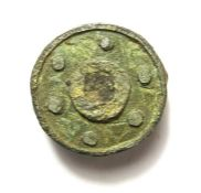 Roman Disk Brooch.  Circa 2nd century AD. Copper-alloy, 5.67 grams. 21.17 mm. A tinned bronze disk