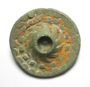Roman Brooch.  Circa, 2nd century AD. Copper-alloy, 7.32 grams. 26.59 mm. A Roman disc brooch