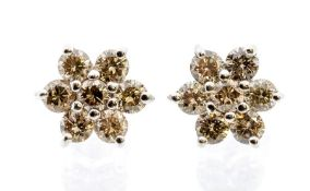 A pair of champagne diamond and 18ct white gold cluster earrings, claw set flower mount, total