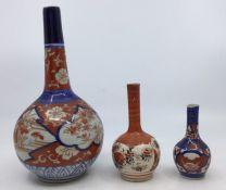 Three Asian onion shaped vases of graduating sizes, Imari and Satsuma (3)