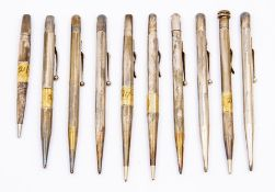 A collection of 10 silver engine turned propelling pencils mainly Fyne Poynt, some stamped