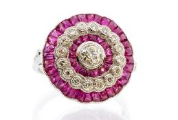 A ruby and diamond platinum flower cluster, the principal old cut diamond weighing approx 0.25ct,