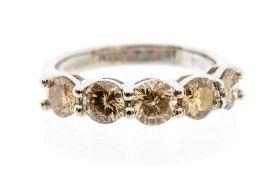 A five stone diamond and 18ct white gold ring, comprising five claw set brilliant cut diamonds