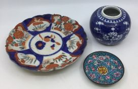 A group of Chinese Imari including charger and plates, painted with floral decoration in various