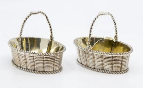 A pair of George III silver and parcel gilt oval basket shaped salts with rope twist borders and