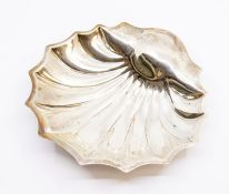 An Edwardian silver shell shaped butter dish on three ball feet, by Atkin Brother, Sheffield,