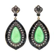 A pair of silver gilt jade and onyx drop earrings, comprising pear cut jade cabochons set to the