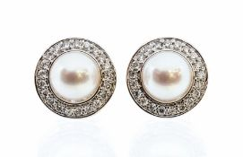 A pair of pearl and diamond 9ct white gold cluster earrings, comprising cultured pearls set to the