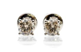 A pair of diamond and 18ct white gold studs, the four claw set, round brilliant cut diamonds