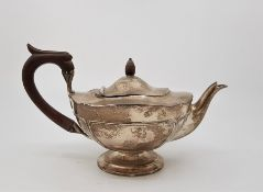 A silver teapot, by Walker & Hall, assayed Sheffield 1910. with wooden finial and loop handle. (