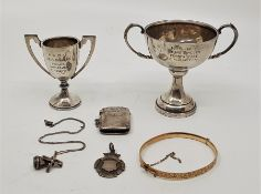 Two silver twin handled trophy cups, both engraved winner N.S.R.C. tennis, mens singles and