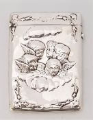 A silver card case, by Horton & Allday, assayed Birmingham 1902, the front repousse cherubs within a