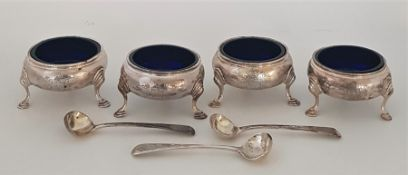 "A set of four George III silver circular salts, by ""I*M"", assayed London 1762, with blue glass"