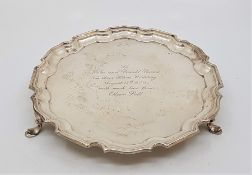 A silver circular salver, by Mappin & Webb Ltd, assayed Sheffield 1958, having stepped scroll