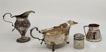 A silver sauce boat, by Bramwell & Co, Sheffield 1932, together with an Edwardian silver cream