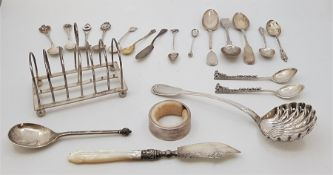 A small collection of silver table ware, to include: a six division silver toast rack, by
