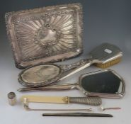 An early 20th century rectangular silver dressing table tray with embossed decoration. Birmingham