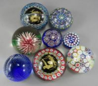 A small blue ground St Kilda Millefiori paperweight. 5cm diameter. Together with a pale blue