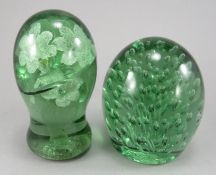 A 19th century North Country green glass dumpy weight with many internal bubble inclusions. 12cm