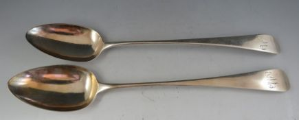 """A pair of Geo III """"Old English"""" pattern silver basting spoons. London 1803 makers marks obscured"""